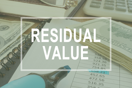 Residual value. Office table with business documents.