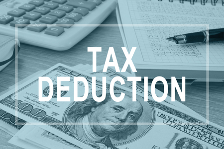 Tax deductions. Office table with financial report.