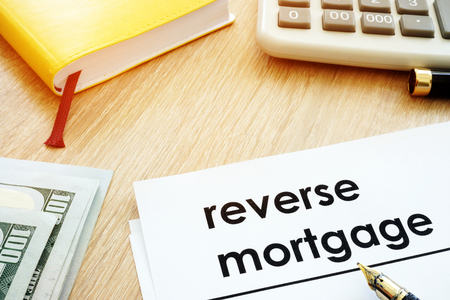 Reverse mortgage concept. Documents and calculator on a desk.