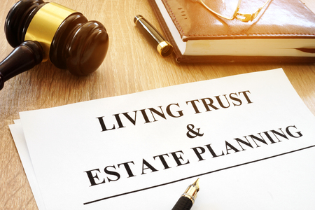 Living trust and estate planning form on a desk. Imagens