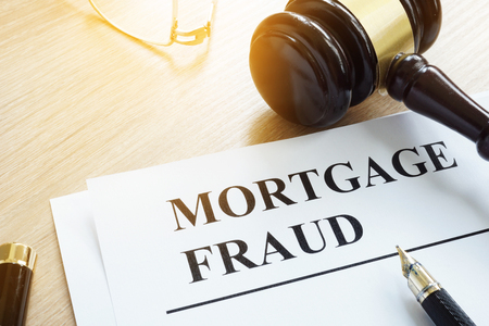 Mortgage fraud evidences and gavel on a desk.