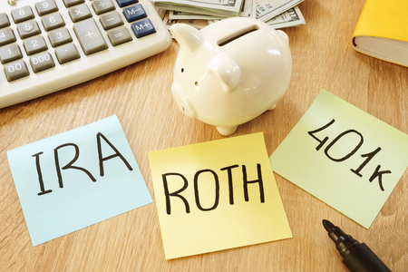 Memo sticks with words IRA 401k ROTH. Retirement plans. Stock Photo