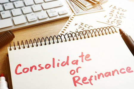 Consolidate or refinance handwritten in a notepad.