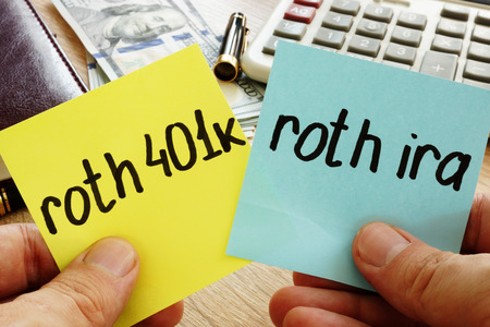 Man holding sticks with roth 401k vs roth ira. Retirement. Stock Photo