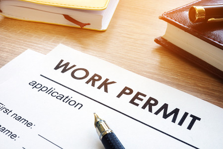 Work permit application on a table. Archivio Fotografico - 104482636