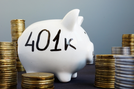 Retirement plan. Piggy bank with word 401k.