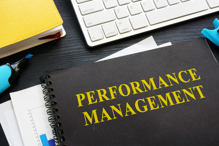 Performance management documents on an office table.