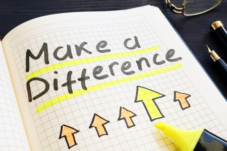 Make a difference handwritten in notepad. Stock Photo