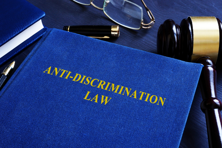 Anti-discrimination law and gavel in the court.