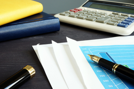 Audit. Business or financial report and calculator. Archivio Fotografico