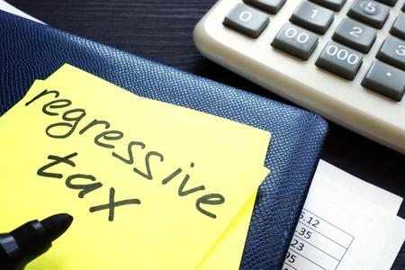 Regressive tax written on a memo stick. Imagens