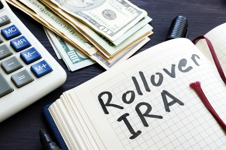 Rollover ira handwritten in a notepad. Retirement. Stock Photo - 106213383