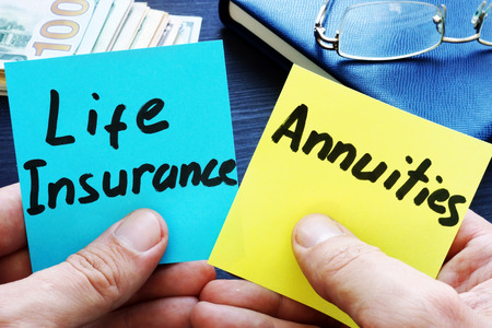Man holding memo sticks. Life Insurance vs. Annuities.