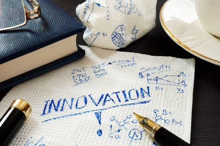 Innovation and business creative ideas written on a napkin. Stock Photo