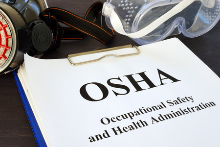 Pile de documents avec Occupational Safety and Health Administration OSHA.
