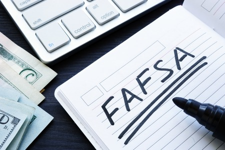 FAFSA handwritten in a note. Free Application for Federal Student Aid.