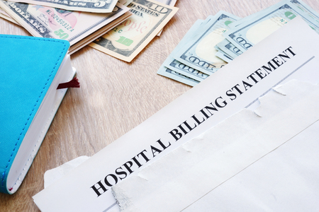 Hospital billing statement in the envelope. Medical debt. 写真素材