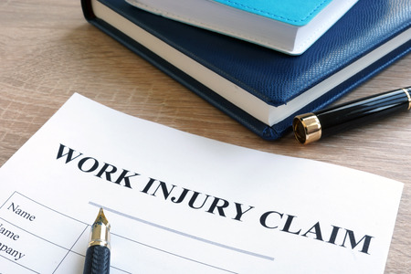 Work injury claim form and note pad.