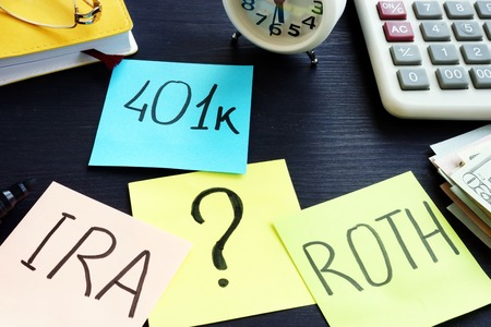 401k ira roth on pieces of paper. Retirement planning. Stock Photo - 109688979