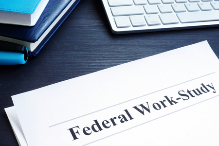 Federal Work Study FWS program documents and pen.