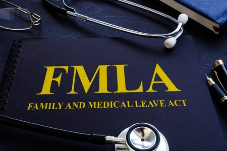 FMLA family and medical leave act and stethoscope. Stockfoto
