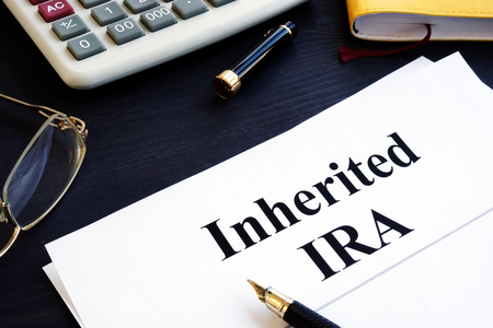Inherited IRA documents on a table. Retirement plan. Stock Photo - 113803819