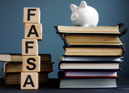 FAFSA Free application for federal student aid. Letters on the cubes. 版權商用圖片