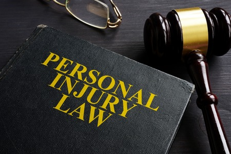 Personal Injury Law book and a black desk.