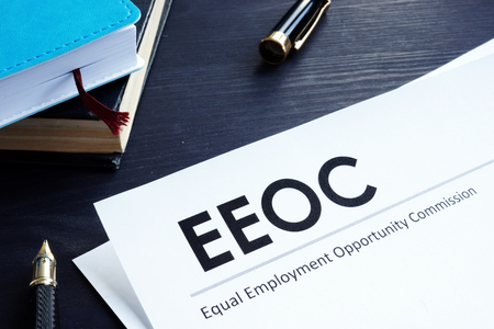 Equal Employment Opportunity Commission EEOC document and pen on a table. Stock fotó