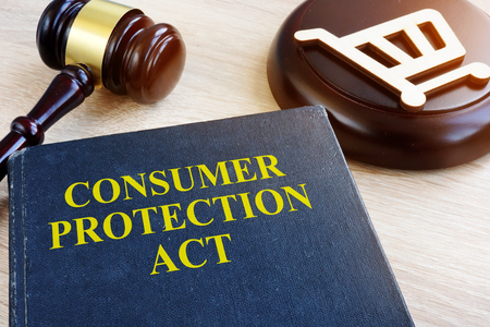 Consumer protection act and gavel on a table. Stock Photo