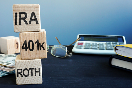 Cubes with words IRA, 401k and ROTH. Retirement plan. Stock Photo