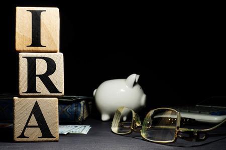 Word ira individual retirement account from wooden cubes. Stock Photo