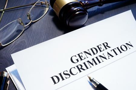 Document about Gender Discrimination and gavel on a desk.