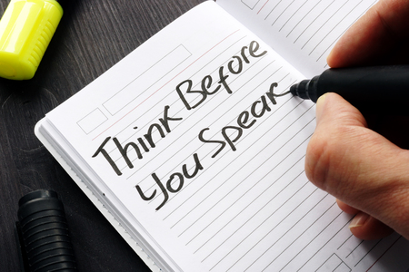 Think Before You Speak handwritten on a note.