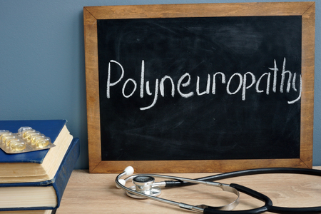 Polyneuropathy written on a blackboard. Stock Photo