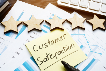 Five stars and customer satisfaction. Documents on a desk.