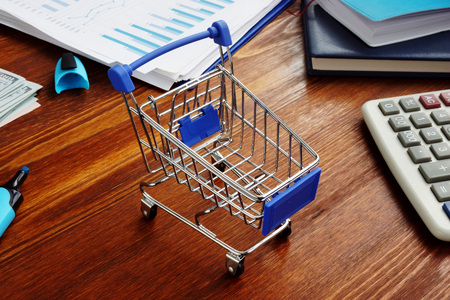 Retail marketing. Shopping cart on an office desk.