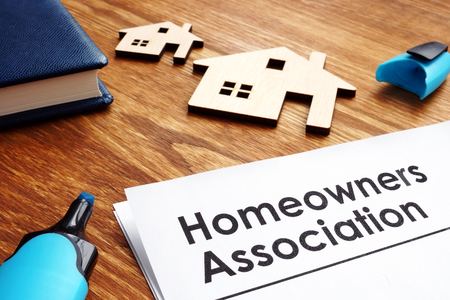 Documents about Homeowners Association HOA on a desk. Stockfoto