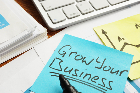 Grow your business concept. Financial documents on a table. 版權商用圖片