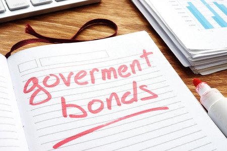 Government bonds. Notepad and papers on a desk.