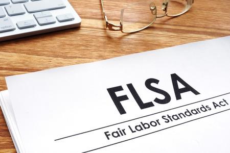 Fair labor standards act FLSA on a desk.