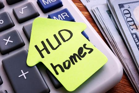HUD homes written on a piece of paper. Reklamní fotografie