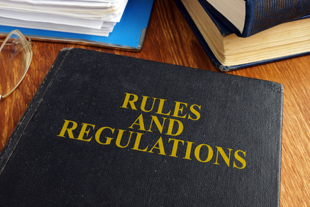 Rules and regulations book on the desk.