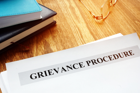 Grievance procedure documents on a table.