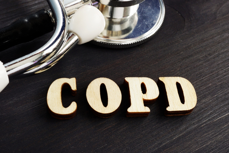 Abbreviation COPD Chronic obstructive pulmonary disease from wooden letters. Stock Photo