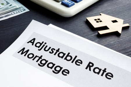Adjustable Rate Mortgage ARM documents on a table.