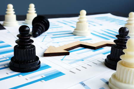 Chess and business reports with financial graphs. Strategy and risk management. 版權商用圖片