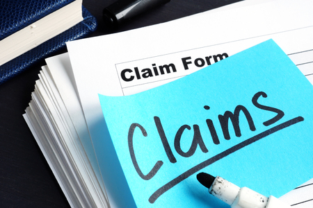 Stack of Claims applications on a desk. Banque d'images
