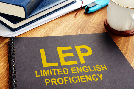 Limited English Proficiency LEP documents on a desk. Stock Photo