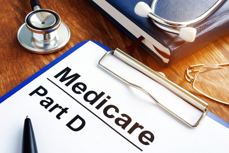 Medicare Part D documents with clipboard on a desk. 스톡 콘텐츠